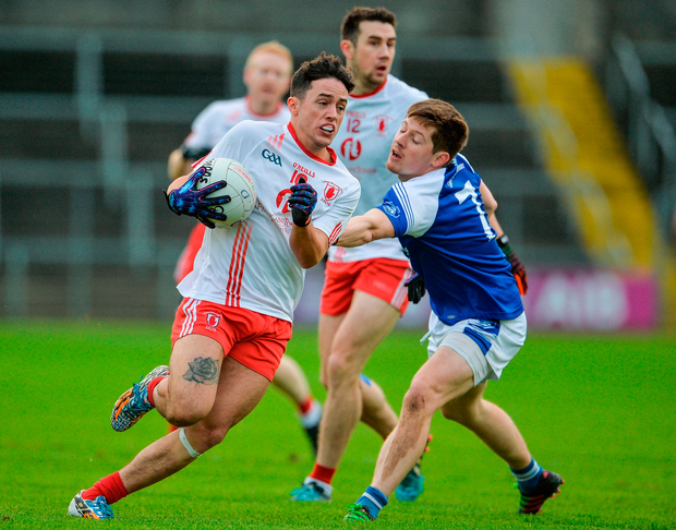 Eoin McKeown of Lamh Dhearg in action against Levi Murphy of Cavan Gaels. Photo by Oliver McVeigh/Sportsfile