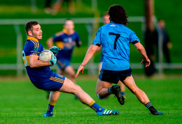Brian Ennis of Summerhill in action against Niall Kane of Simonstown Gaels. Photo by Piaras Ó Mídheach/Sportsfile