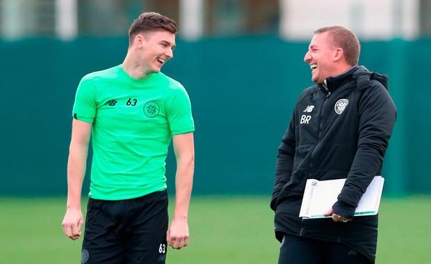 Kieran Tierney of Celtic and Brendan Rodgers manager of Celtic share a joke