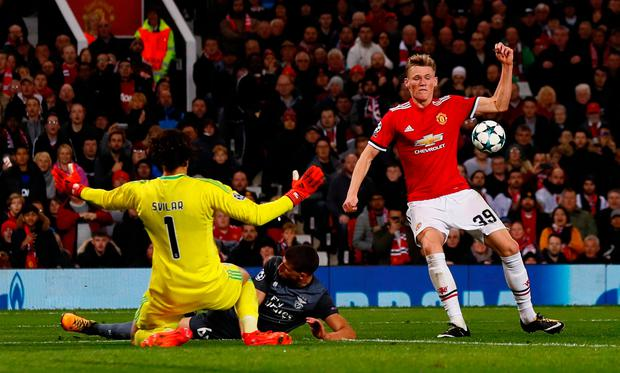 Manchester United's Scott McTominay in action with Benfica's goalkeeper Mile Svilar. Photo: Reuters/Jason Cairnduff