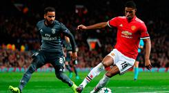 Marcus Rashford (right) controls the ball under pressure from Benfica's Pereira Douglas (left). Photo: PA