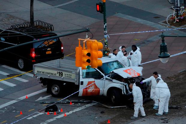 Police investigate a vehicle allegedly used in a ramming incident on the West Side Highway in Manhattan, New York, U.S., October 31 2017. REUTERS/Andrew Kelly
