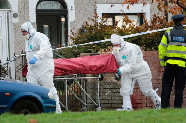 Jamie Tighe's body is removed from the murder scene