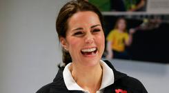 The Duchess of Cambridge laughs during a briefing on a visit at the Lawn Tennis Association (LTA) at the National Tennis Centre in southwest London