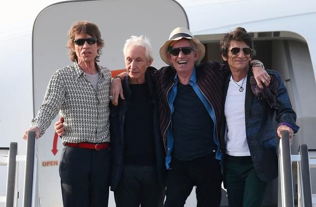 Mick Jagger, Charlie Watts, Keith Richards and Ronnie Wood of the Rolling Stones exit their plane after landing at the Jose Marti International Airport on March 24, 2016 in Havana, Cuba