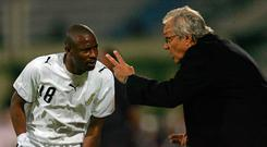 Port Said, EGYPT: Ghanaian team coach Ratomir Dujkovic from Serbia, gives instructions to Abubakari Yakubu (18) during the knock-out round game between Ghana's Black Stars and Senegal's Teranga Lions in the group D of the African Nations Cup (CAN) preliminary, played in Port Said, north of Cairo 27 January 2006. AFP PHOTO/ISSOUF SANOGO (Photo credit should read ISSOUF SANOGO/AFP/Getty Images)