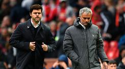 Tottenham Hotspur's Argentinian head coach Mauricio Pochettino (L) and Manchester United's Portuguese manager Jose Mourinho (R) walk off at half time in the English Premier League football match between Manchester United and Tottenham Hotspur at Old Trafford in Manchester, north west England, on October 28, 2017. / AFP PHOTO / Oli SCARFF /