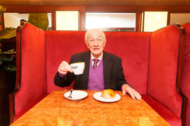 Bewley's oldest customer Denis Shields (86yrs old) got to sit in his favourite seat of Bewley's on Grafton Street Photo: Leon Farrell/Photocall Ireland
