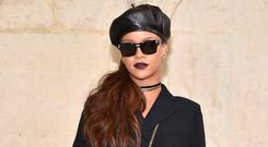 Rihanna was the first to step out in Dior's black leather beret. Photo: Pascal Le Segretain/Getty Images for Dior