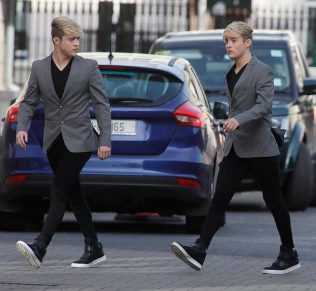 John and Edward Grimes arrive at the High Court yesterday. Photo: Collins