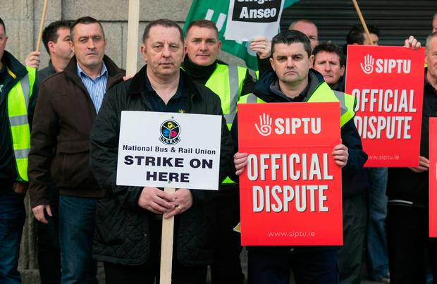 Iarnród Éireann staff Stephen Moles from Navan and Tommy Wynne from Tallaght on a picket with colleagues outside Hueston Station in Dublin. Photo: Gareth Chaney/Collins