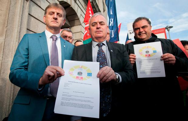 (L to R) Siptu transport division organiser Greg Ennis, NBRU general secretary Dermot O'Leary & TSSA general secretary Manuel Cortez with a letter to the National public transport provider calling for a credible pay proposal to end industrial action. Photo: Gareth Chaney Collins