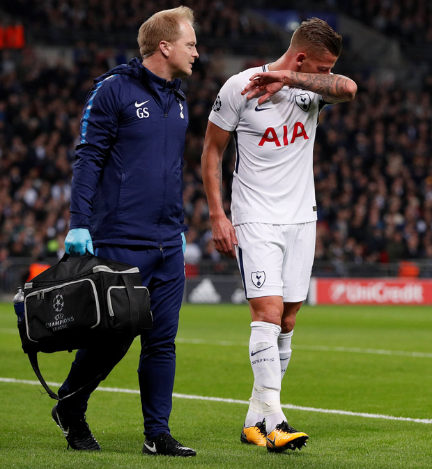 Tottenham's Toby Alderweireld leaves the pitch with his team's physio after sustaining an injury. Photo: Reuters