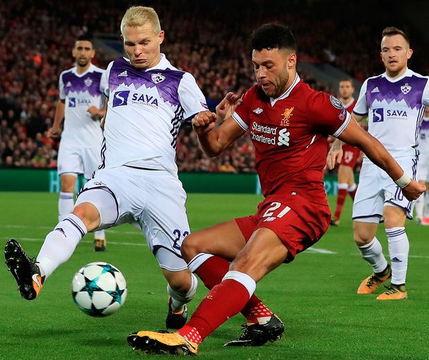 Liverpool's Alex Oxlade-Chamberlain and Maribor's Martin Milec battle for possession. Photo: PA