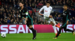 Dele Alli fires his second goal to the net with the aid of a deflection from Sergio Ramos. Photo: Reuters