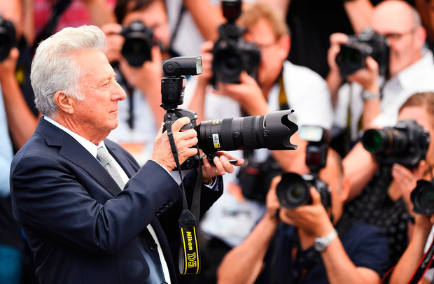 Actor Dustin Hoffman takes a picture as he attends 'The Meyerowitz Stories' photocall during the Cannes Film Festival. Photo: Getty Images