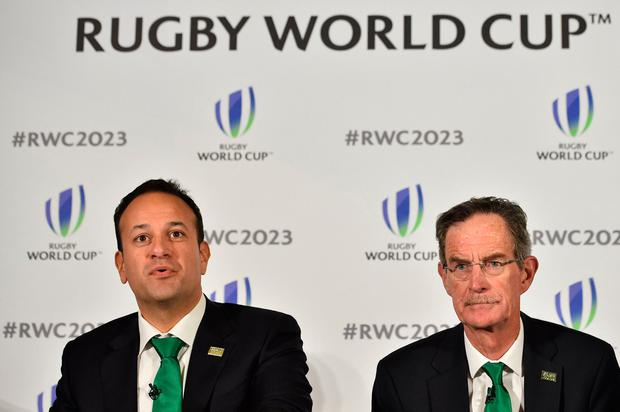 Ireland's Prime Minister Leo Varadkar (L) and Ireland 2023 Bid Chairman Dick Spring take part in a press conference after Ireland presented their bid to host the 2023 Rugby World Cup in London. AFP PHOTO / Glyn KIRK