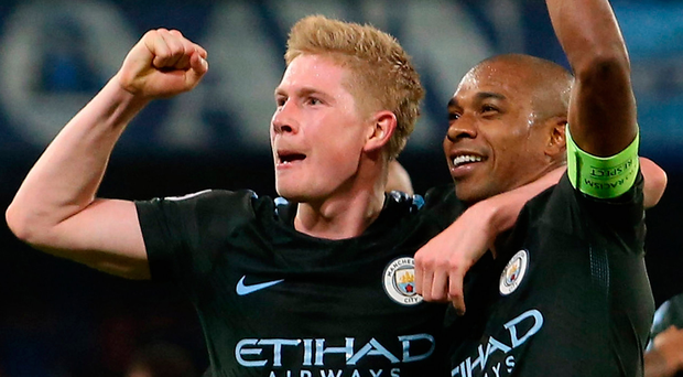 Manchester City's midfielders Kevin De Bruyne and Fernandinho celebrate at the end of their Champions League victory over Napoli. Photo: Getty Images