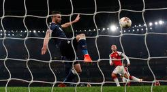Red Star Belgrade's Damien Le Tallec clears off the line from Arsenal's Jack Wilshere. Photo: REUTERS/David Klein