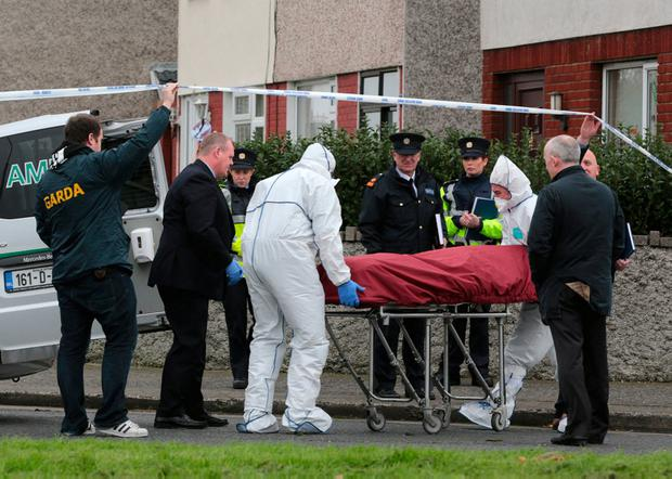Jamie Tighe's body is removed from the scene of his murder in Coolock