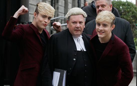 Jedward with their barrister, Desmond Murphy SC, at the Four Courts yesterday. Photo: Collins