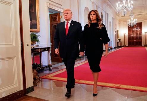 President Donald Trump and first lady Melania Trump walk in to speak on the opioid crisis in the East Room of the White House in Washington, Thursday, Oct. 26, 2017. (AP Photo/Pablo Martinez Monsivais)