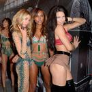 (L-R) Stella Maxwell, Jasmine Tookes and Adriana Lima pose backstage during the Victoria's Secret Fashion Show on November 30, 2016 in Paris, France. (Photo by Dominique Charriau/Getty Images for Victoria's Secret)