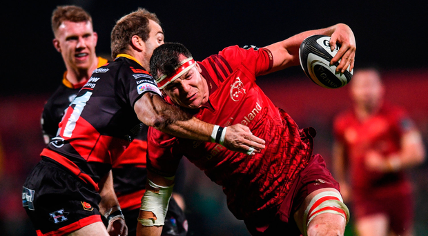 Munster's Robin Copeland is tackled by Sarel Pretorius of Dragons at Irish Independent Park last night. Photo by Eóin Noonan/Sportsfile