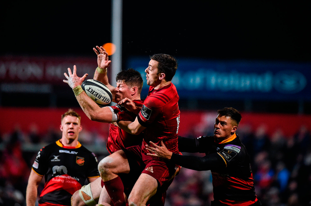 Jack O'Donoghue and Darren Sweetnam of Munster in action against Jared Rosser of Dragons. Photo by Matt Browne/Sportsfile