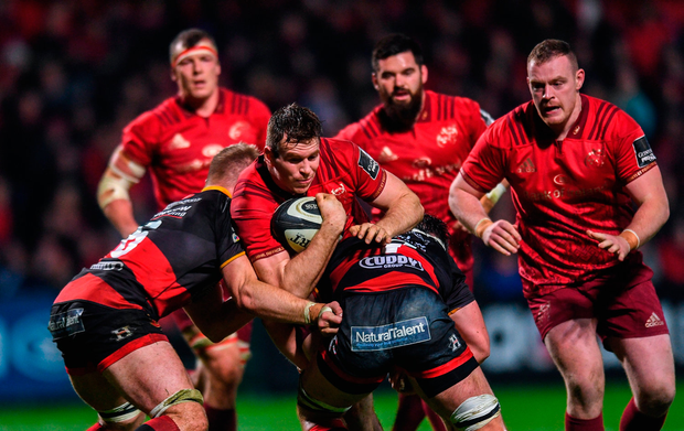 Chris Farrell of Munster is tackled by Aaron Wainwright, left and James Benjamin of Dragons. Photo by Eóin Noonan/Sportsfile