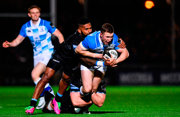 Rory O'Loughlin of Leinster is tackled by Niko Matawalu of Glasgow Warriors. Photo by Ramsey Cardy/Sportsfile
