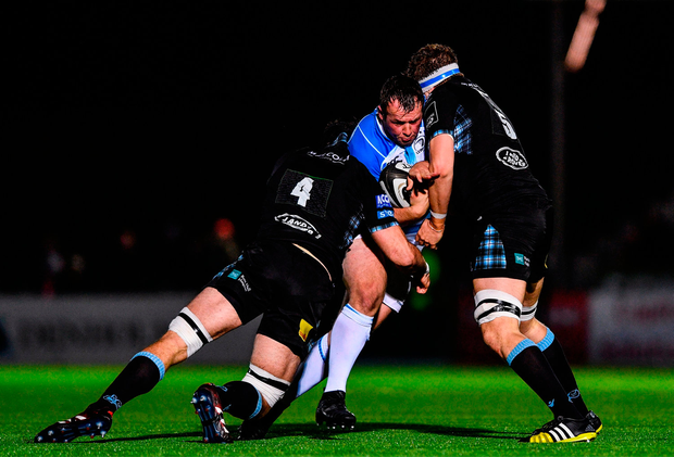 Ed Byrne of Leinster is tackled by Jamie Bhatti, left, and Scott Cummings of Glasgow Warriors. Photo by Ramsey Cardy/Sportsfile