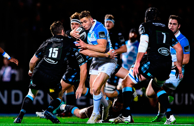 Jordan Larmour of Leinster is tackled by Ruaridh Jackson of Glasgow Warriors. Photo by Ramsey Cardy/Sportsfile