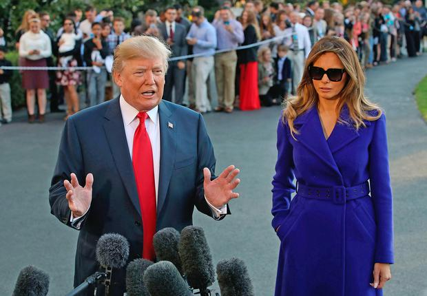 President Trump (pictured talking to the media with his wife Ivana) is embarking on a five- country, 11-day tour throughout Asia. Photo: Getty Images