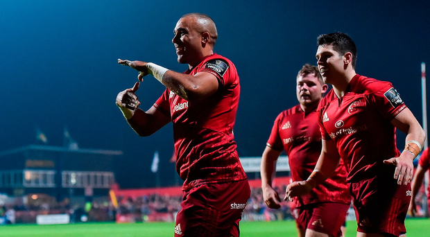 Simon Zebo of Munster celebrates after scoring the second try against the Dragons at Irish Independent Park