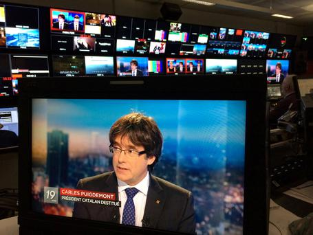 Ousted Catalan President Carles Puigdemont appears on a monitor during a live TV interview at the Belgian RTBF studio in Brussels, Belgium, November 3, 2017. RTBF Television via REUTERS