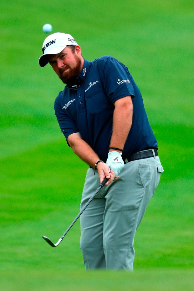 Shane Lowry of Ireland chips to the 16th green