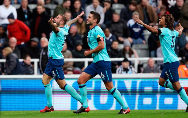 Soccer Football - Premier League - Newcastle United vs AFC Bournemouth - St James' Park, Newcastle, Britain - November 4, 2017 Bournemouth's Steve Cook celebrates scoring their first goal with Andrew Surman (C) and Nathan Ake (R). REUTERS/Scott Heppell