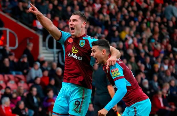Burnley's Sam Vokes celebrates scoring his sides first goal of the game with Burnley's Matthew Lowton during the Premier League match at St Mary's Stadium, Southampton. Adam Davy/PA Wire.
