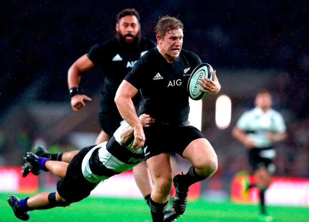 New Zealand's Nathan Harris on his way to scoring a try against the Barbarians at Twickenham Photo: David Davies/PA Wire