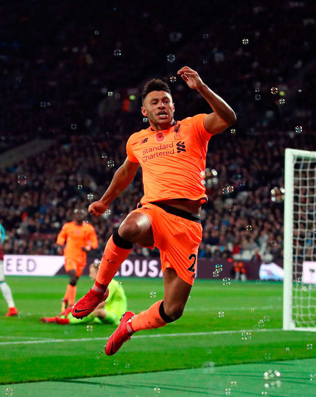 Liverpool's Alex Oxlade-Chamberlain celebrates scoring his side's third goal of the game. Photo: PA Wire