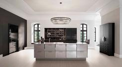 SieMatic and Mick De Giulio, the famous kitchen designer, have worked together to introduce polished chrome and nickel glass doors into their kitchen designs; arenakitchens.com
