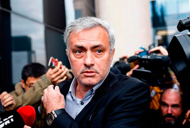 Manchester United manager Jose Mourinho leaves a court in Madrid where he faced tax fraud allegations during the week. Photo: Getty Images