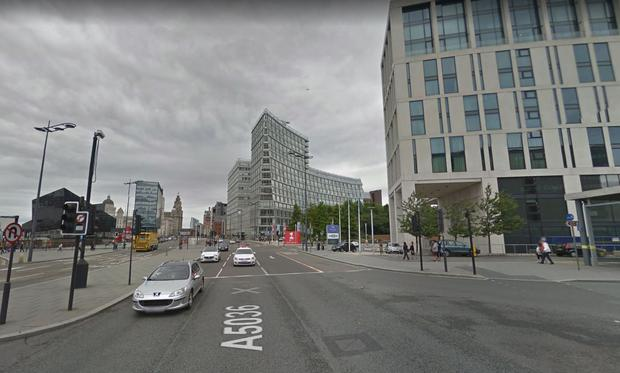 The man was hit by a car close to the Hilton Hotel on The Strand in Liverpool.