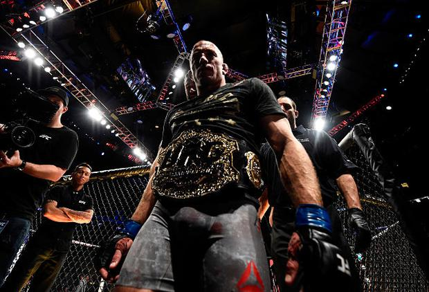 Georges St-Pierre of Canada celebrates his submission victory over Michael Bisping of England in their UFC middleweight championship bout during the UFC 217 event inside Madison Square Garden on November 4, 2017 in New York City. (Photo by Brandon Magnus/Zuffa LLC/Zuffa LLC via Getty Images)
