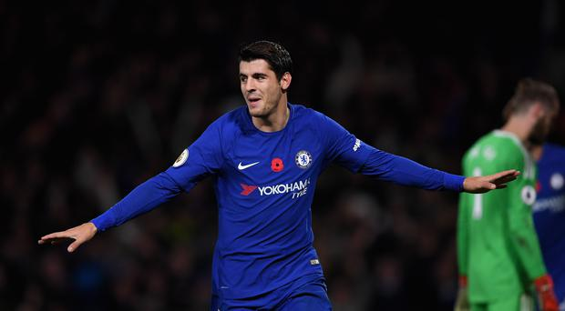 Alvaro Morata of Chelsea celebrates scoring his sides first goal during the Premier League match between Chelsea and Manchester United at Stamford Bridge on November 5, 2017 in London, England. (Photo by Darren Walsh/Chelsea FC via Getty Images)