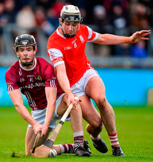 Jake Malone of Cuala battles for possession with Dicksboro's Thomas Kenny. Photo: Sportsfile