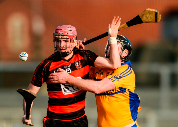 Ballygunner's Billy O'Keeffe brushes off Sixmilebridge's Jamie Shanahan during yesterday's AIB Munster Club SHC semi-final. Photo by Piaras Ó Mídheach/Sportsfile