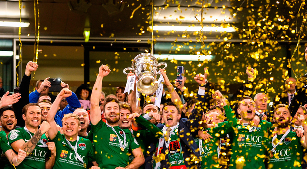 Cork City's players celebrate as captain Alan Bennett lifts the FAI Cup. Photo: Sportsfile