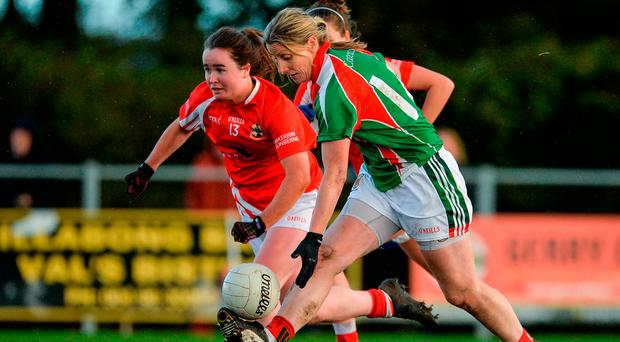 Staunton soloing past Nicola Ward of Kilkerrin-Clonberne in Ballyhaunis yesterday. Photo by Oliver McVeigh/Sportsfile